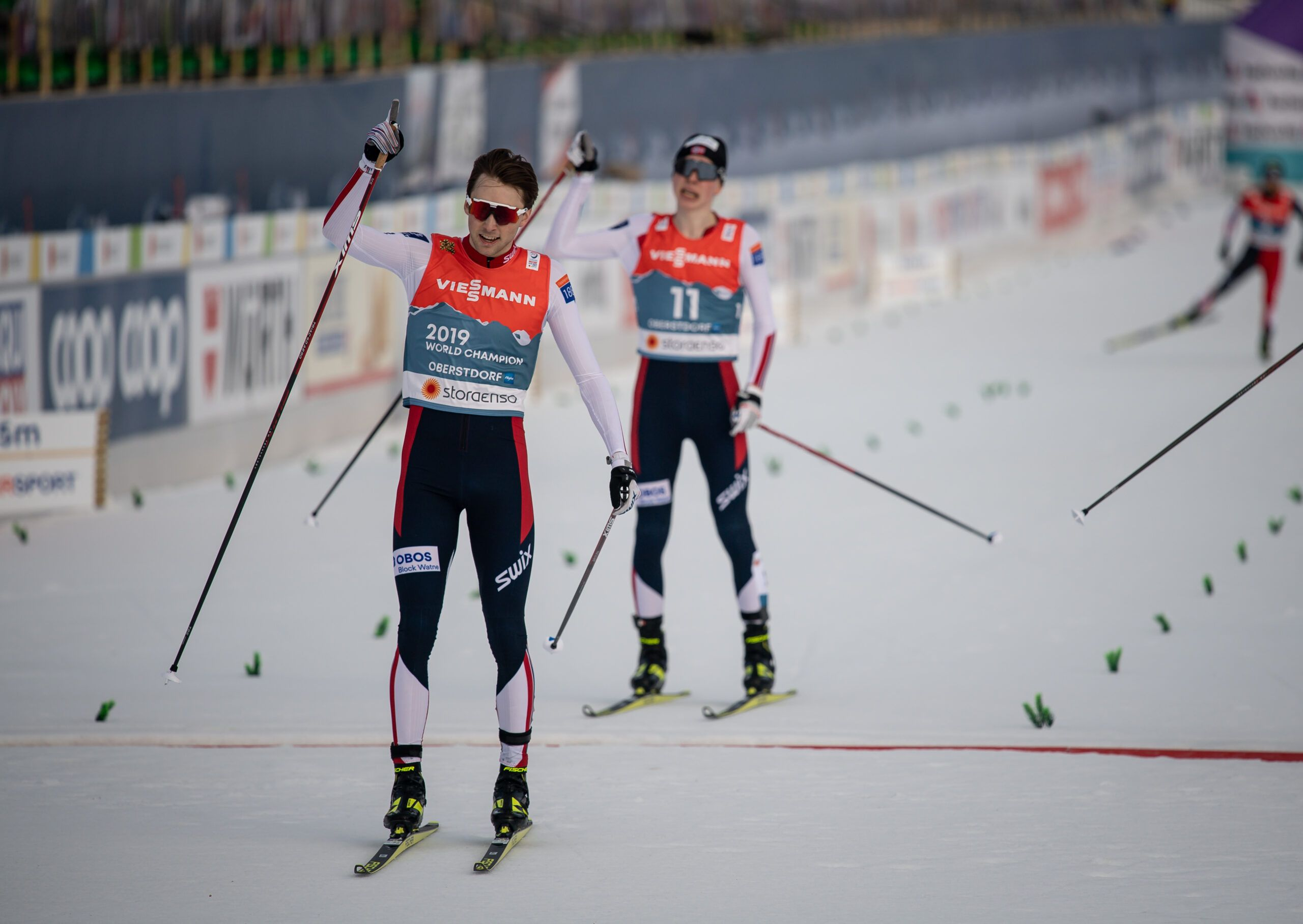 Jarl Magnus Riiber From Norway Left Crosses The Finish Line During Nordic Combined Men Individual Gundersen Nh100Km Scaled